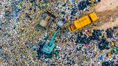 Garbage Pile  In Trash Dump Or Landfill, Aerial View Garbage Trucks Unload Garbage To A Landfill,  G poster