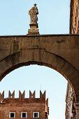 Arch And Statue Near Piazza Delle Erbe In Verona, Veneto, Italy