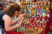 MOSCOW - JULY 26: Unidentified tourists choose a Matryoshka at the gift shop on July 26, 2012 in Mos