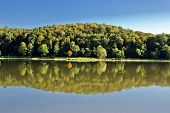 Idyllic Autumn Reflections On Lake Surface