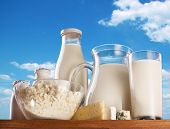 Dairy products on the sky background.