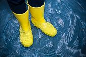 picture of wet feet  - rubber boots in the water - JPG