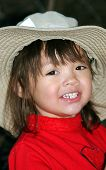 Little Girl With Big Hat