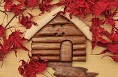 Woodcraft Cabin House And Dry Maple Leaves