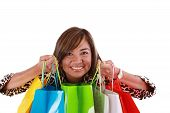 Beautiful Shopping Woman Holding Shopping Bags Looking To The Camera. Isolated On White Background