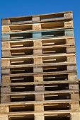 Pallets stacked in a pile outside