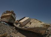 Derelict Boats In The Desert At Night