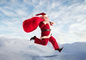 Santa Claus running in the sky
