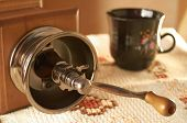 picture of wooden box from coffee mill  - Manual coffee grinder and ceramic cup on woven tablecloth - JPG