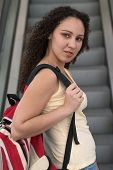 Young Latina Student With Backpack poster