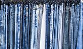 picture of character traits  - A rack of a variety of blue denim jeans in various shades of blue - JPG