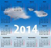 Calendar for 2014 year in Spanish with clouds in the blue sky