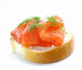 Sandwich with red fish (salmon) and dill on a white background
