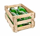 vintage wooden wine crate filled with white wine bottles