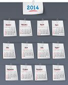 Calendar For 2014 Year On Sticky Notes Attached To The Linen Background With Paper Clips