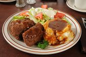 stock photo of meatloaf  - Meatloaf dinner with mashed potatoes and gravy with a green salad - JPG