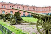 stock photo of artillery  - Old vintage Russian artillery systems and equipment on green grass - JPG