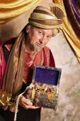 Arabian Genie bringing a treasure chest with gold and jewelry