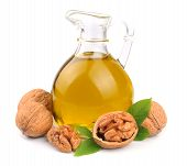 foto of walnut  - Walnuts oil and walnuts isolated on white background - JPG