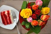picture of red velvet cake  - Red Velvet Cake with Roses in the background - JPG