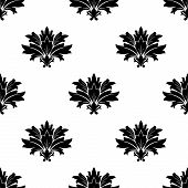 Black foliate motif in a seamless pattern