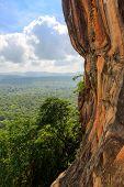 rocky wall of Sigiriya castle over jungle