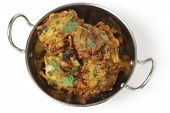 Homemade onion bhaji Indian appetisers in a kadai serving bowl, seen from above