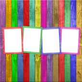 Four Multicolored Frames On The Wooden Background