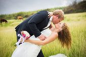 Wedding Couple, Happy romantic bride and groom kissing