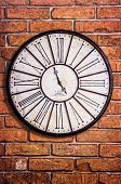 Old Vintage Clock On Textured Brick Wall