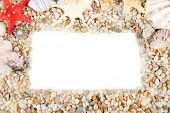 Frame of small sea stones and shells, isolated on white