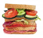a sandwich with vegetables and spanish chorizo and salchichon, on a white background