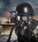 Pollution.Environmental disaster. Post apocalyptic survivor in gas mask