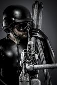 Sniper with huge plasma rifle, fantasy concept, military helmet and goggles motorcyclist. airsoft