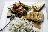 stock photo of halibut  - Dish of halibut with rice and vegetables - JPG