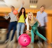 picture of bowler  - Group of four young smiling people playing bowling - JPG