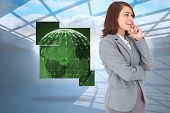 Happy businesswoman against room with holographic cloud