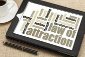 foto of laws-of-attraction  - law of attraction word cloud on a digital tablet with cup of coffee - JPG