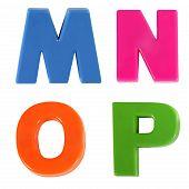 Four Letters Written In Multicolored Plastic Kids Letters