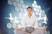 Businesswoman sitting in lotus pose against technological background with hexagons