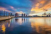 West Palm Beach, Florida skyline at sunset.
