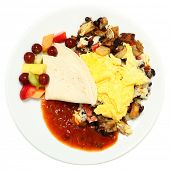 Mexican Eggs with Salsa, Potatoes, Fruit over white.