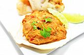 foto of scallop-shell  - Fancy Stuffed Scallop Shell Served with Fresh Lime Wedges - JPG