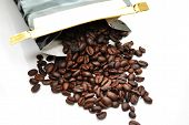 Fresh Coffee Beans Spilling Out Of A Bag