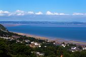 foto of anglesey  - Looking along the Anglesey coast on a sunny day - JPG