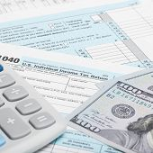 United States Of America Tax Form 1040 With Calculator And Us Dollars