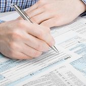 United States Of America Tax Form 1040 - Man Performing Tax Calculations