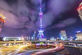 SHANGHAI, CHINA - JUNE 18, 2014: The landmark Oriental Pearl Tower at night in Lujiazui Financial Di