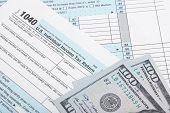 Usa 1040 Tax Form With Two 100 Us Dollar Banknotes Over It - Studio Shoot