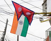 KATHMANDU, NEPAL - AUGUST 3, 2014: Nepalese and Indian flags in the street of Kathmandu for Indian Prime Minister Narendra Modi 2-day official Nepal visit.